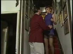 Redhead Bun Fraulein On Red Carpet Stairs